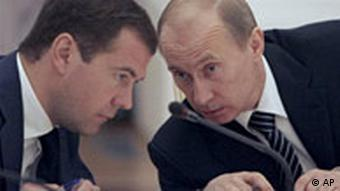 Dmitry Medvedev and Vladimir Putin chatting