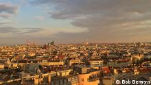 Description: Sunset over Vienna, Austria. Title: rooftops Series title: Green cities Tags: climate change, heatwaves, cities, Vienna, global warming, reflective roofs Photographer: Bob Berwyn Date: April 2017 Location: Vienna Situation: City planners want to reshape the roofscapes of cities like Vienna by replacing dark-colored tiles with light-colored coatings or vegetation that help reflect the sun's warmth rather than trapping it, but they face big challenges in dense urban areas where many buildings stand under historic preservation protection. declaration of rights: I hereby declare that I took this photograph and am giving DW the right to use it online and for social media. In case the picture was taken by a third party, I do hold the rights to this image and DW is entitled to use it online. Bob Berwyn