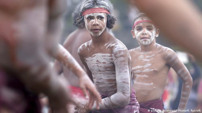 Young members of the Aboriginal community taking part in a traditional smoking ceremony