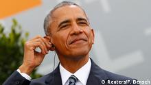 25.05.2017 Former U.S. President Barack Obama adjusts his earpiece as he attends a discussion at the German Protestant Kirchentag in front of the Brandenburg Gate in Berlin, Germany, May 25, 2017. REUTERS/Fabrizio Bensch