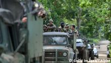 Philippine soldiers ride in miliary vehicles as they leave a military camp to reinforce troops fighting Muslim extremists in the city centre in Marawi, on the southern island of Mindanao on May 25, 2017. Philippine troops aboard helicopters and in armoured tanks battled Islamist militants inside a southern city on May 25, as reports emerged of the gunmen murdering civilians. / AFP PHOTO / TED ALJIBE (Photo credit should read TED ALJIBE/AFP/Getty Images)