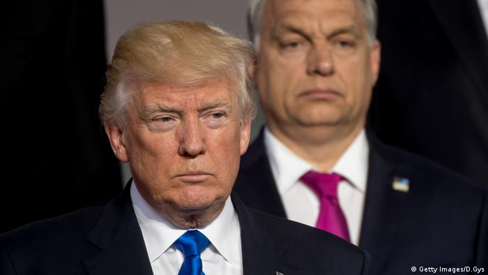 US President Donald Trump stands in front of Hungarian Prime Minister Viktor Orban in 2017