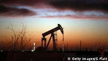 January 20, 2016*** ANDREWS, TX - JANUARY 20: An oil pumpjack works at dawn in the Permian Basin oil field on January 20, 2016 in the oil town of Andrews, Texas. Despite recent drops in the price of oil, many residents of Andrews, and similar towns across the Permian, are trying to take the long view and stay optimistic. The Dow Jones industrial average plunged 540 points on Wednesday after crude oil plummeted another 7% and crashed below $27 a barrel. (Photo by Spencer Platt/Getty Images)