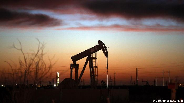 An oil pumpjack works at dawn in the Permian Basin oil field in the oil town of Andrews, Texas