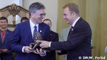 Bürgermeister von Lwiw Andrij Sadowy empfängt den Bürgermeister von Freiburg Dieter Salomon. Autor: Wiktoria Pryhid - DW-Korrespondentin in Lwiw (Ukraine)