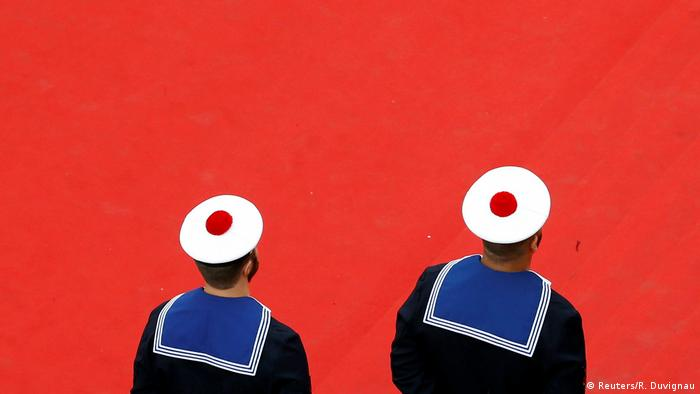 French navy sailors stand on the red carpet during the 70th Cannes Film Festival. The Palme d'Or prize presented at the festival is considered to be one of the most prestigious awards in the film industry.