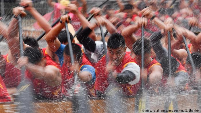 Competing teams drive their colorful dragon boats forward to the rhythm of beating drums at the Dragon Boat Festival on a river in Guangzhou city, in south China's Guangdong province.