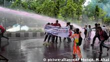 Bangladeshi policemen use water cannon to disperse activists protesting against the removal of a Lady Justice statue in Dhaka, Bangladesh, Friday, May 26, 2017. A Lady Justice statue was removed from Bangladesh's Supreme Court premises under tight security overnight after Islamist hardliners pressed for its removal for months, the sculptor said Friday. (AP Photo/ A.M. Ahad)