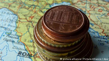 Italian map and euro coins