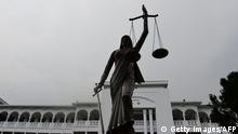 A statue denounced by religious hardliners as un-Islamic is pictured on the grounds of the Supreme Court in Dhaka after it was reinstalled on May 28, 2017. Bangladesh on May 28 reinstalled a controversial statue deemed un-Islamic by religious hardliners on the grounds of the Supreme Court, just days after its removal had sparked angry protests by secular groups. / AFP PHOTO / - (Photo credit should read -/AFP/Getty Images)