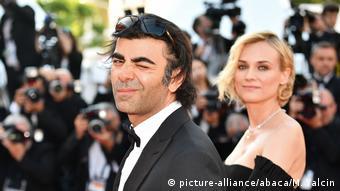 Cineasta turco-alemão Fatih Akin, tendo ao fundo Diane Kruger, prêmio de melhor atriz