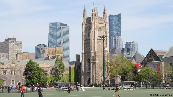 A sports field and buildings at the University of Toronto