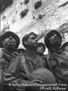 Israeli paratroopers next to the Western Wall in Jerusalem's Old City on June 7, 1967