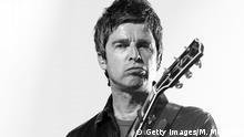 Noel Gallagher mit Gitarre und Schmollmund (Getty Images/M. Metcalfe)