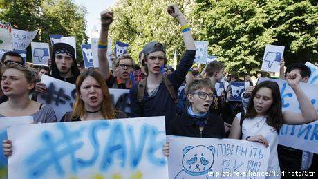 Young Ukrainians protesting a ban on Russian social media platforms and web services