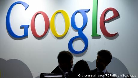Sign of Google with silhouettes of people