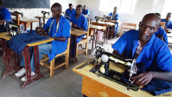 Former FDLR fighters using sewing machines at Mutombo Camp