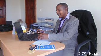 Major Placide Ndayambaje, a former FDLR commander, working on a computer