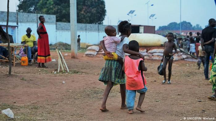 Three refugee children from DRC in an Angolan camp. (UNICEF/N. Wieland)