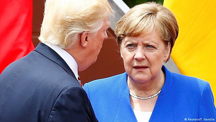 US President Donald Trump and Germany's Chancellor Angela Merkel at the G7 summit in Italy,