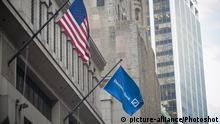 A flag flies outside the Deutsche Bank headquarters on Wall Street in Lower Manhattan in New York on Monday, October 17, 2016. Deutsche Bank reported a fourth-quarter loss of $2.05 billion citing legal costs and uncertainty over its fine to be paid to the U.S. |