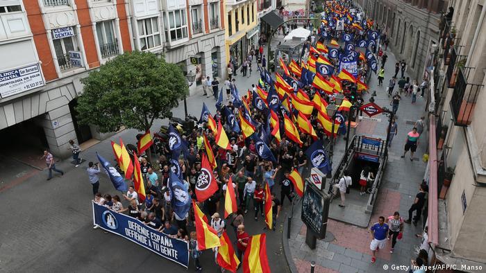 Members of Hogar Social Madrid demonstrate in Madrid