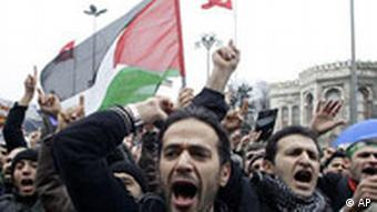 Turkish demonstrators in Istanbul shout slogans as they protest against Israel's Gaza raids