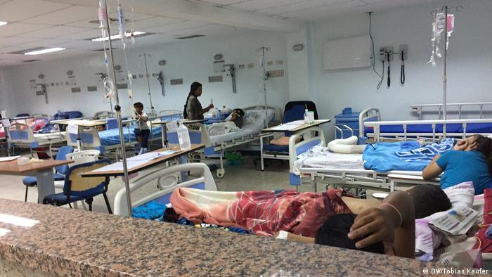 An open hospital ward in Venezuela, with every bed occupied.