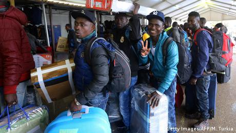 African immigrants from Ivory Coast in an airport in Tripoli, Libya (Getty Images/AFP/M. Turkia)