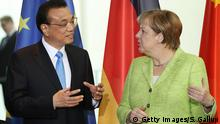 BERLIN, GERMANY - JUNE 01: German Chancellor Angela Merkel and Chinese Prime Minister Li Keqiang attend the signing of joint agreements of intent at the Chancellery on June 1, 2017 in Berlin, Germany. German and Chinese representatives signed a series of agreements at today's ceremony, mostly between German and Chinese companies. The Chinese delegation is in Berlin for two days to meet with the German government over possibilities for further economic and other forms of cooperation. (Photo by Sean Gallup/Getty Images)