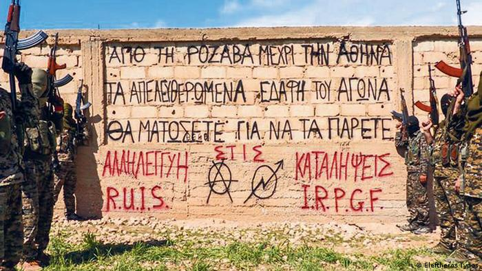 Greek anarchists in Rojava posed with a message for back home from Rojava