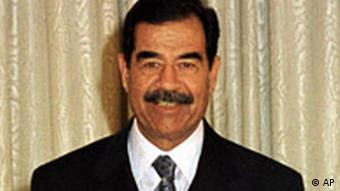 Iraqi President Saddam Hussein makes an address to the nation that was broadcast on Iraqi TV Wednesday, January 17, 2001, on the occasion of the tenth anniversary of the beginning of the allied bombing campaign that drove Iraqi forces out of occupied Kuwait in 1991. Despite the heavy burden of international sanctions Saddam's rule faces no serious threats to his rule . (AP Photo/INA)