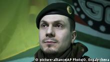 ARCHIV 2015 *** In this photo taken on Monday March 2, 2015, Adam Osmayev, the commander of a battalion of Chechens fighting against Russia-backed rebels, is in the town of Lysychansk, Ukraine. Russian pro-Kremlin newspapers published reports based on unidentified sources in the security services that accused the Ukrainian government and Osmayev of ordering the murder of Russian opposition leader Boris Nemtsov, the claims Osmayev has denied. (AP Photo/Olya Engalycheva)  