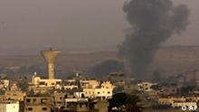 Smoke, seen from southern Israel, rises following an Israeli missile strike in the northern Gaza Strip, next to Israel's border with the Gaza Strip, Tuesday, Dec. 30, 2008. Palestinian militants sent a deadly barrage of missiles flying deep into Israel on Monday, demonstrating that Hamas still had firepower three days into Israel's punishing air offensive in Gaza. (AP Photo/Ariel Schalit)