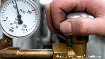 hand closing a gas valve