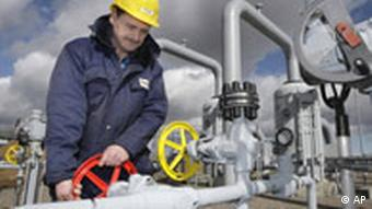 Technician Steffen Weigand works at a valve in the Natural Gas Compress Station in Sayda, eastern Germany, Wednesday, March 12, 2008.