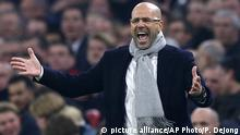 Ajax's coach Peter Bosz screams during the Europa League round of 16, second leg, soccer match between Ajax and Kobenhavn at the Amsterdam ArenA stadium in Amsterdam, Netherlands, Thursday, March 16, 2017. (AP Photo/Peter Dejong) |