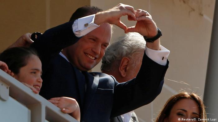 Malta's Prime Minister Joseph Muscat gestures to supporters after his reelection