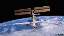 This image of the International Space Station (ISS) was photographed by one of the crewmembers of the STS-105 mission from the Shuttle Orbiter Discovery after separating from the ISS. The STS-105 mission was the 11th ISS assembly flight and its goals were the rotation of the ISS Expedition Two crew with Expedition Three crew, and the delivery of supplies utilizing the Italian-built Multipurpose Logistic Module (MPLM) Leonardo. Aboard Leonardo were six resupply stowage racks, four resupply stowage supply platforms, and two new scientific experiment racks, EXPRESS (Expedite the Processing of Experiments to the Space Station) Racks 4 and 5, which added science capabilities to the ISS. Another payload was the Materials International Space Station Experiment (MISSE), which included materials and other types of space exposure experiments mounted on the exterior of the ISS.