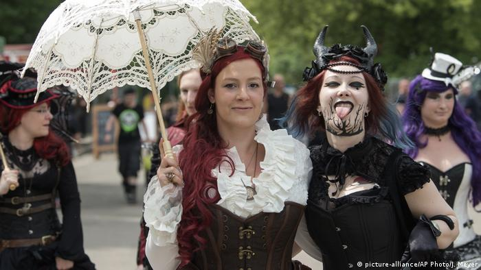 Participants in fancy costumes attend the Wave Gothic Festival in Leipzig