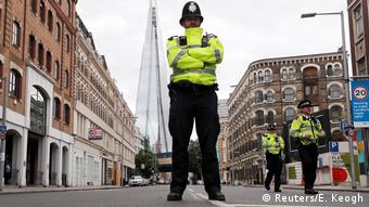 London policeman stands in a street.
