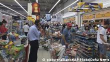 In this photo provided by Doha News, shoppers stock up on supplies at a supermarket in Doha, Qatar on Monday, June 5, 2017 after Saudi Arabia closed its land border with Qatar, through which the tiny Gulf nation imports most of its food. Saudi Arabia and three Arab countries severed ties to Qatar on Monday and moved to cut off land, sea and air routes to the energy-rich nation that is home to a major U.S. military base, accusing it of supporting regional terror groups. (Doha News via AP) |
