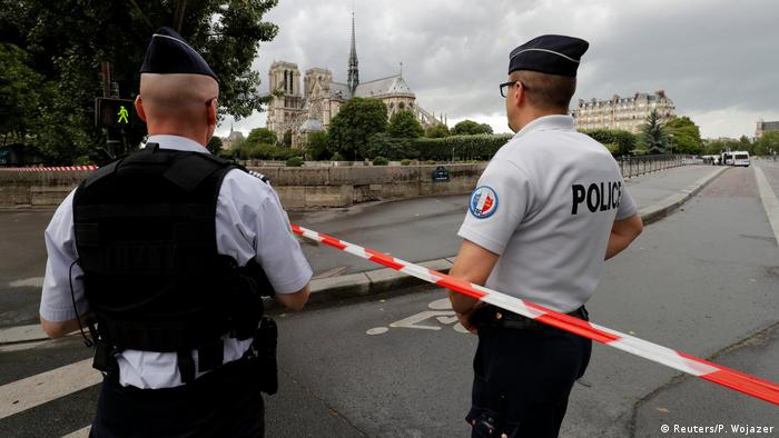 Police cordon off an area around Notre Dame