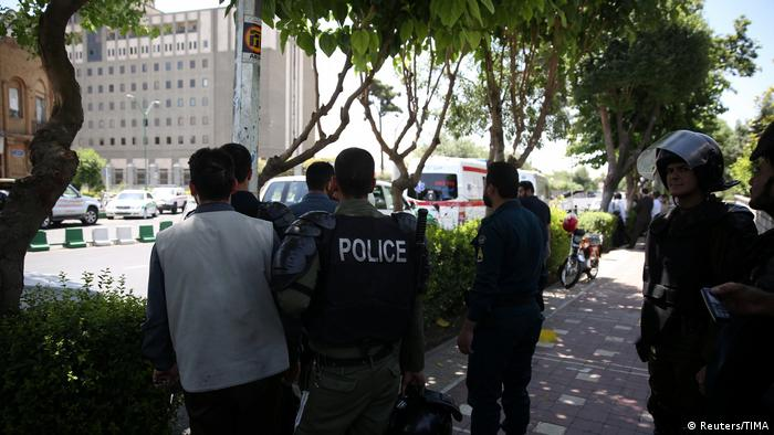 Iranian security forces surround the parliament building during an attack