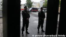epa03261428 Russian policemen guard the office of the NGO Rospil where anti-corruption blogger Alexey Navalny is a leader during a search of the premises by investigators in Moscow, Russia, 12 June 2012. Prominent Russian anti-corruption blogger and lawyer Alexei Navalny is being escorted from the Investigative Committee office, where he has been questioned, to the office of the NGO Rospil. EPA/SERGEI ILNITSKY |