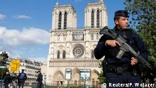 06.06.2017 *** French police and gendarmes stand at the scene of a shooting incident near the Notre Dame Cathedral in Paris, France, June 6, 2017. REUTERS/Philippe Wojazer