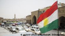 Kurdistan flag waving on the wind in Erbil, 28 May, 2016, Kurdistan (Photo by Krystian Dobuszynski/NurPhoto) | Keine Weitergabe an Wiederverkäufer.