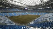 ARCHIV - Blick am 27.02.2017 in das neue Fußballstadion in St. Petersburg, Russland.In Russland findet 2017 der FIFA Confed Cup und 2018 die FIFA Fußball-Weltmeisterschaft statt. (zu dpa-Meldung: «Spielorte und Stadien beim Confed Cup in Russland» vom 23.05.2017) Foto: Dmitri Lovetsky/AP/dpa +++(c) dpa - Bildfunk+++ |