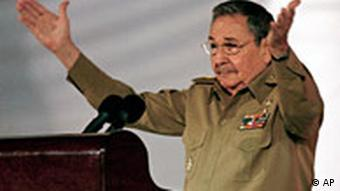Cuban president Raul Castro, his arms outstretched, speaking at a the country's 50th anniversary celebrations on Jan. 1, 2009.