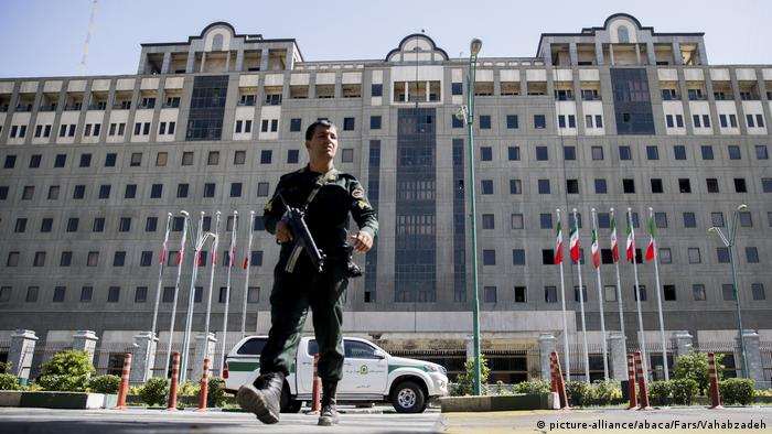 Members of the Iranian Revolutionary Guard secure the area outside the Iranian parliament following two attacks in the capital